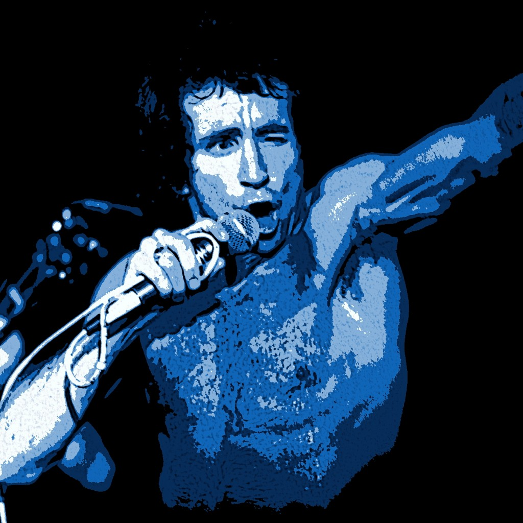 BON SCOTT OF AC-DC PERFORMING LIVE IN SPOKANE, WA. ON 7-26-78. PHOTO BY BEN UPHAM. MAGICAL MOMENT PHOTOS.