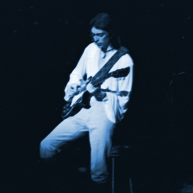STEVE HACKETT OF GENESIS PERFORMING LIVE IN BERKELEY, CALIFORNIA ON APRIL 29, 1976. PHOTO BY BEN UPHAM. MAGICAL MOMENT PHOTOS.