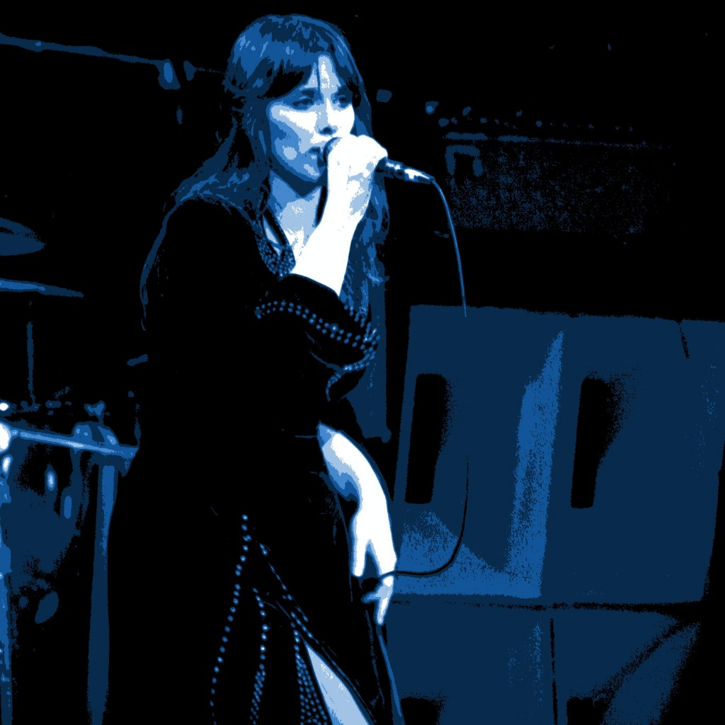 Heart performing in Oakland, California on 12-31-77. Photo by Ben Upham. Magical Moment Photos. Ann Wilson on Vocals.