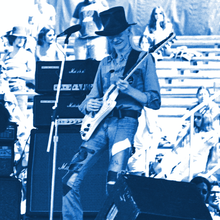 "JOHNNY WINTER PERFORMING LIVE IN CONCERT AT ""DAY ON THE GREEN"" IN OAKLAND, CALIFORNIA ON 9-20-75. PHOTO BY BEN UPHAM. MAGICAL MOMENT PHOTOS."