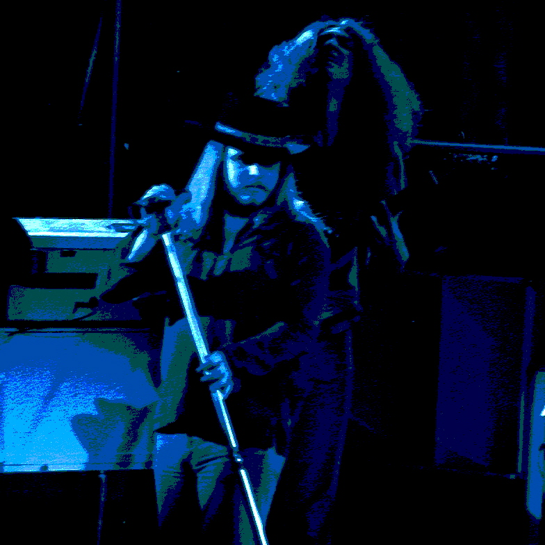 RONNIE VAN ZANT AND ALLEN COLLINS OF LYNYRD SKYNYRD AT WINTERLAND ON 3-6-76. PHOTO BY BEN UPHAM. MAGICAL MOMENT PHOTOS.