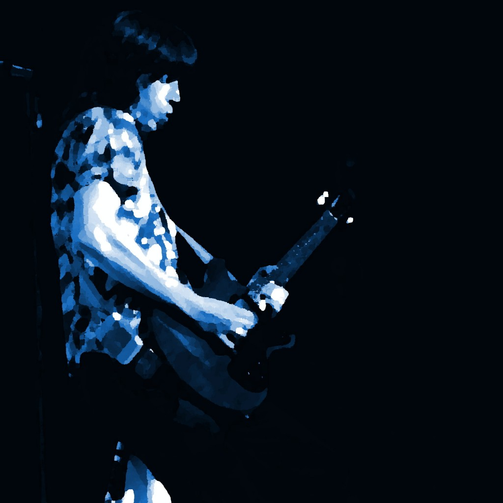 PAT TRAVERS PERFORMING LIVE IN CONCERT IN SEATTLE, WA. ON 2-23-78. PHOTO BY BEN UPHAM. MAGICAL MOMENT PHOTOS.