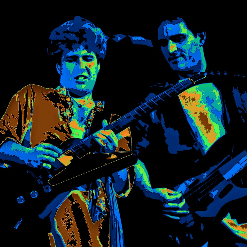 SAMMY HAGAR AND BILL CHURCH PERFORMING LIVE IN OAKLAND ON 12-31-77. PHOTO ART BY BEN UPHAM. MAGICAL MOMENT PHOTOS.
