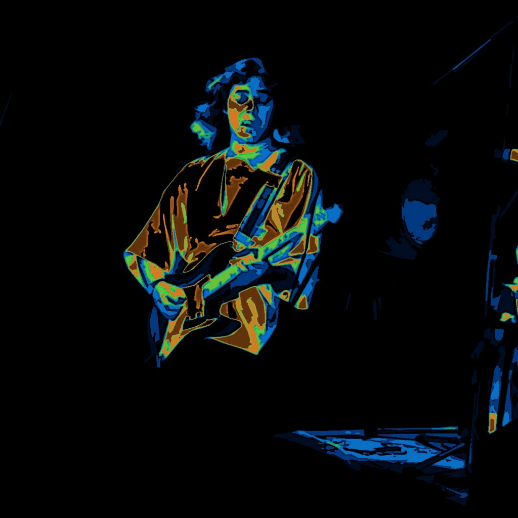 TOMMY BOLIN AT WINTERLAND ON 5-7-76. PHOTO BY BEN UPHAM. MAGICAL MOMENT PHOTOS.