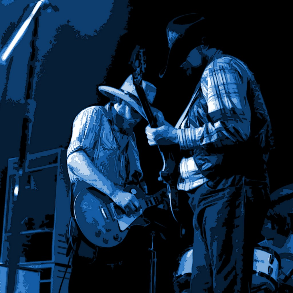 TOM CRAIN AND CHARLIE DANIELS ROCKING OUT AT WINTERLAND ON 12-13-75. PHOTO BY BEN UPHAM.MAGICAL MOMENT PHOTOS.