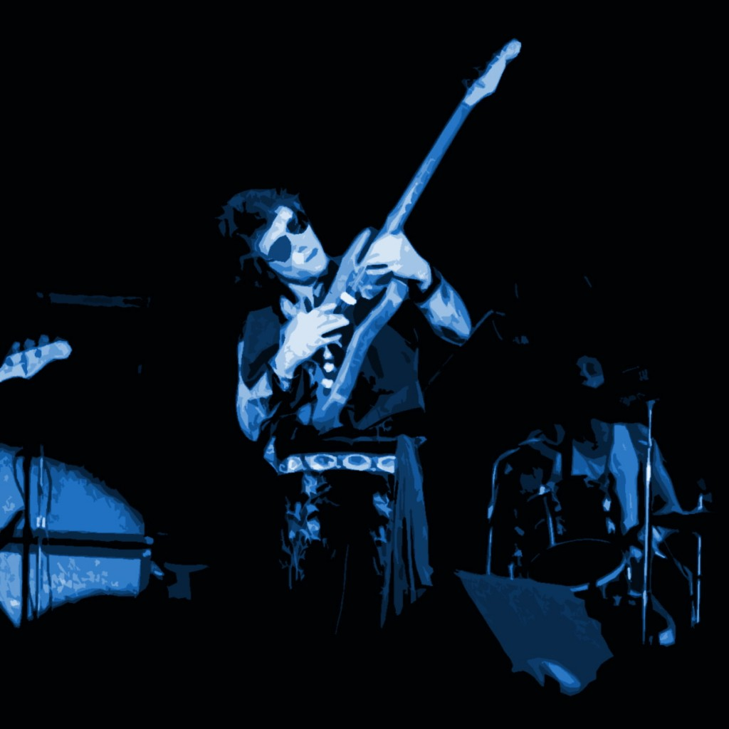 NILS LOFGREN PERFORMING LIVE AT WINTERLAND IN SAN FRANCISCO ON OCTOBER 11, 1975. PHOTO BY BEN UPHAM. ,MAGICAL MOMENT PHOTOS.